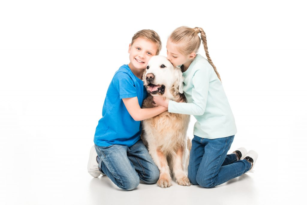 Children with family dog