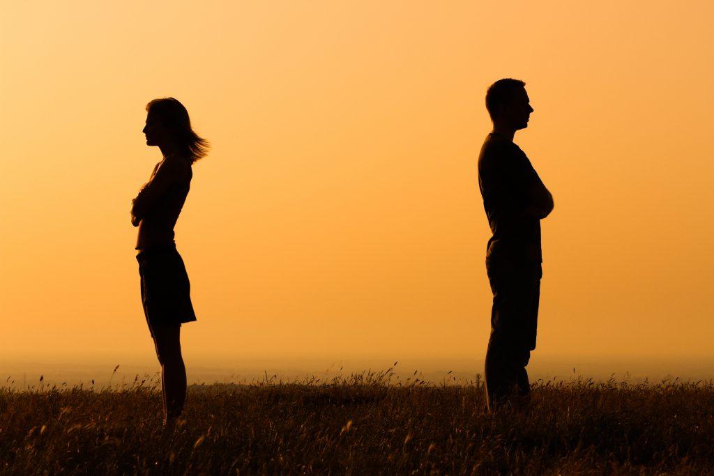 Couple Standing Apart